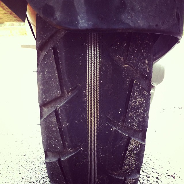 Motorcycle tire worn to the cords