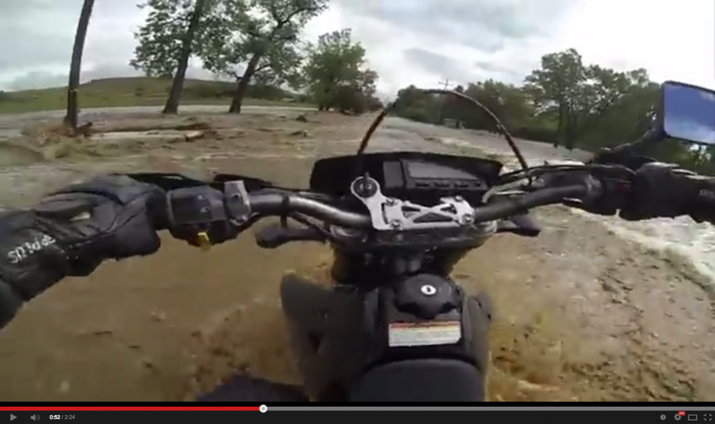 Motorcycle Tries to Cross Flash Flood